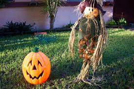 Scarecrow and jack-o-lantern in front yard